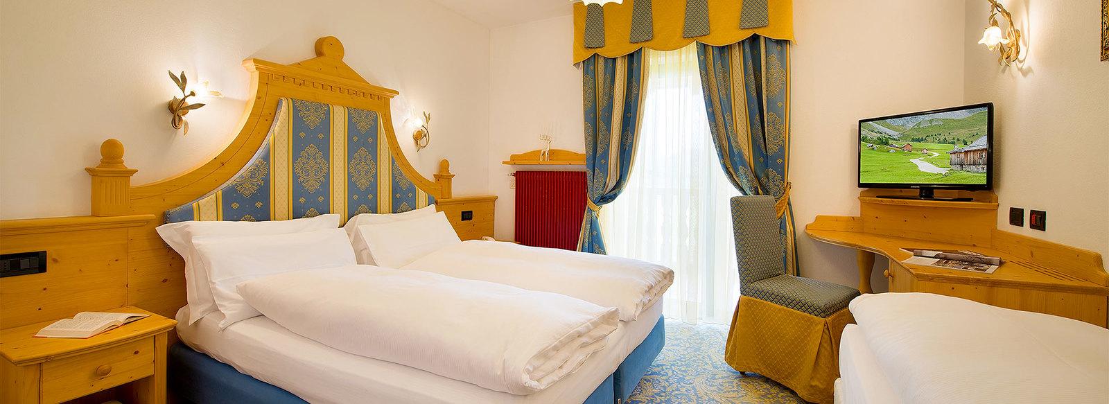 Storico ed elegante hotel 3*S nel cuore della Val di Fassa
